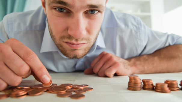 Desperate businessman counting his change